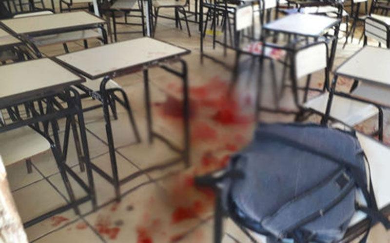 Imagem ilustrativa da notícia: Estudante invade escola armado e fere dois colegas